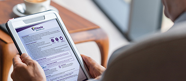 Prostate cancer patient reading the ERLEADA® (apalutamide) Patient Guide on a tablet