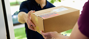 Delivery driver handing a ERLEADA® (apalutamide) package to recipient