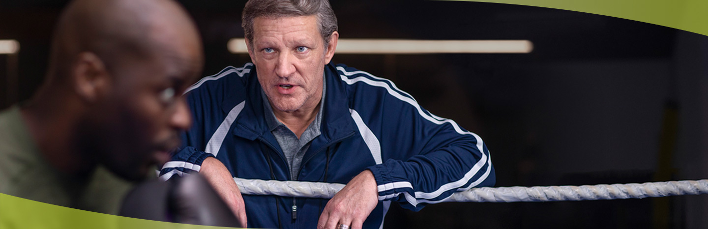 Boxing coach with prostate cancer from ERLEADA® (apalutamide) commercial coaching student